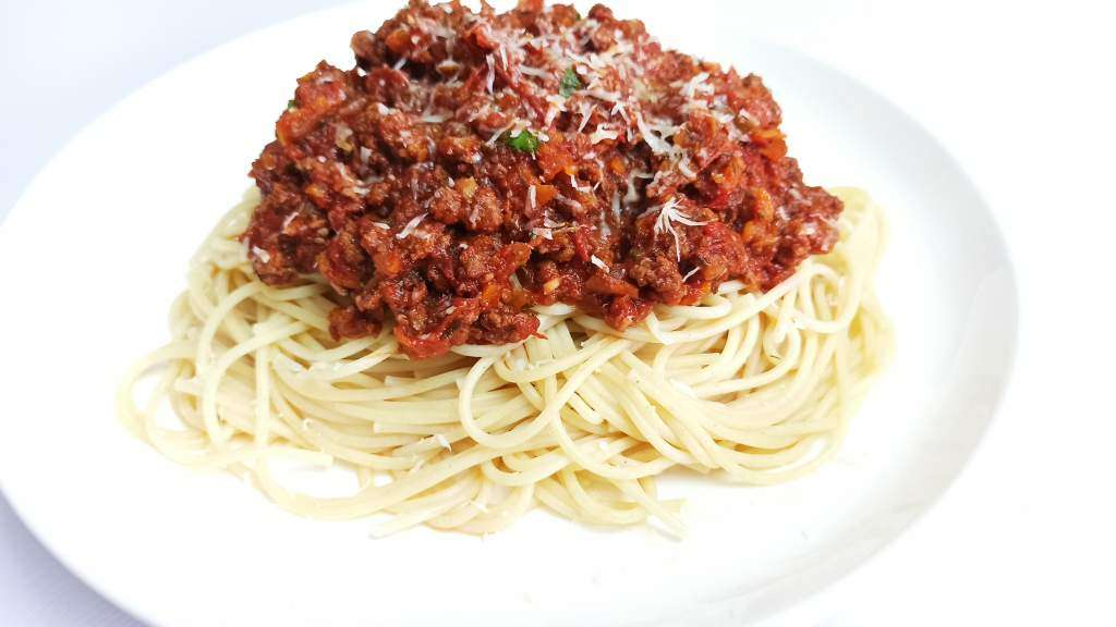 Easy Homemade Spaghetti Bolognese with a topping of parmesan cheese